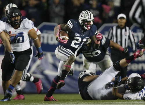 Scott Sommerdorf   |  The Salt Lake Tribune Brigham Young Cougars running back Jamaal Williams (21) gains yardage during fourth quarter play. BYU defeated Boise State 37-20, Friday, October 25, 2013.