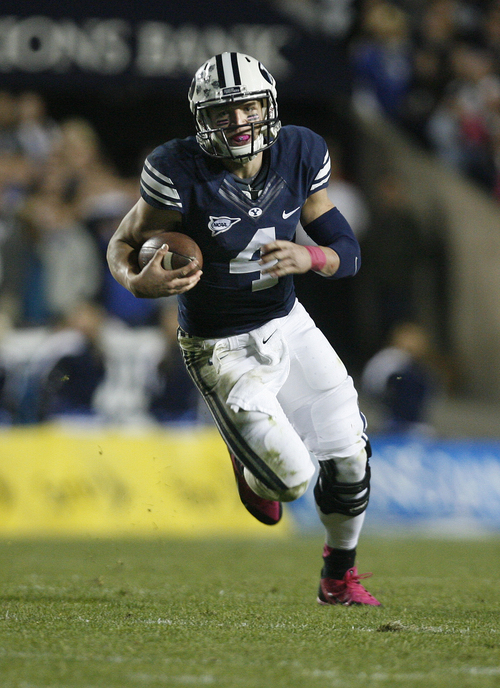 Scott Sommerdorf   |  The Salt Lake Tribune BYU QB Taysom Hill runs during fourth quarter play. BYU defeated Boise State 37-20, Friday, October 25, 2013.