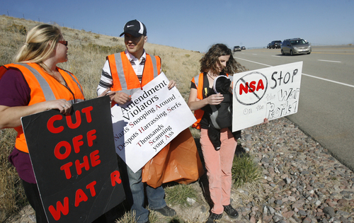 Scott Sommerdorf   |   The Salt Lake Tribune Lorina Potter, left, and Shan and Amy Morris talk while the group Restore the Fourth (amendment) is having its first cleanup on Redwood Road in front of the new NSA Data Center. The group adopted the road, using the cleanup as a Rally Against Mass Surveillance on Saturday.