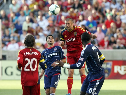 Kim Raff  |  The Salt Lake Tribune (middle right) Real Salt Lake defender Chris Wingert (17) heads the ball over (middle left) Chicago Fire midfielder Dilly Duka (8) during the first half of the match at Rio Tinto Stadium in Sandy on May 25, 2013.