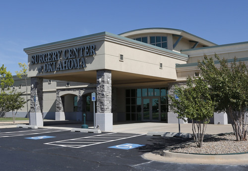 This Wednesday, Oct. 9, 2013 photo shows the entrance to Surgery Center of Oklahoma in Oklahoma City. The center posts their prices on their website and say they offer better deals than other providers because they don't charge a huge facility fee, which is a big price driver for hospitals or other surgery centers. (AP Photo/Sue Ogrocki)