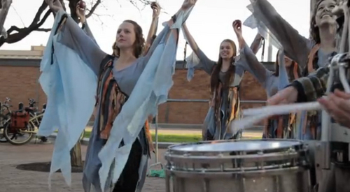"(Courtesy of Zack Brym  |  Screenshot) Marcia Brym, right, plays ""Naturally Prune"" tree as Zack drums in ""Prune to Wild."""