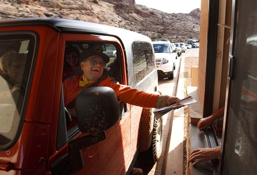 Leah Hogsten | The Salt Lake Tribune On Saturday, there was a minimum 15-minute wait time for Wade Monutz of Colorado Springs and others trying to get through the entrance to Arches National Park, October 12, 2014.Thanks to a $1.7 million payment from Utah taxpayers, the national parks of southern Utah are being exempted from the federal government shutdown just in time for a traditionally busy fall weekend.