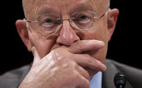 Director of National Intelligence James Clapper pauses while testifying on Capitol Hill in Washington, Tuesday, Oct. 29, 2013, before the House Intelligence Committee hearing on potential changes to the Foreign Intelligence Surveillance Act (FISA). Faced with anger over revelations about U.S. spying at home and abroad, members of Congress suggested Tuesday that programs the Obama administration says are needed to combat terrorism may have gone too far. (AP Photo/ Evan Vucci)