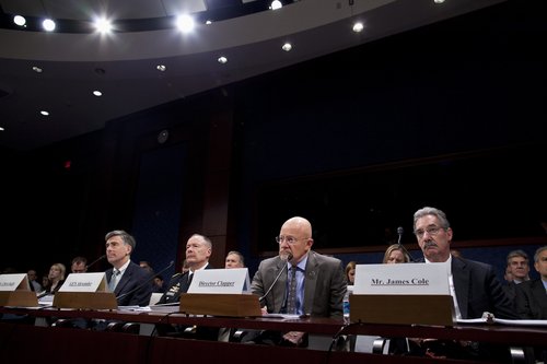 From left, Deputy National Security Agency Director Chris Inglis, National Security Agency Director Gen. Keith Alexander, Director of National Intelligence James Clapper and Deputy Attorney General James Cole, testify on Capitol Hill in Washington, Tuesday, Oct. 29, 2013, before the House Intelligence Committee hearing on potential changes to the Foreign Intelligence Surveillance Act (FISA). Faced with anger over revelations about U.S. spying at home and abroad, members of Congress suggested Tuesday that programs the Obama administration says are needed to combat terrorism may have gone too far. (AP Photo/ Evan Vucci)