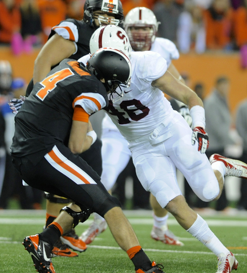 Oregon State's quarterback Sean Mannion (4) is sacked by Stanford's Kevin Anderson (48) during the second half of an NCAA college football game in Corvallis, Ore., Saturday Oct. 26, 2013. Stanford beat Oregon State 20-12. (AP Photo/Greg Wahl-Stephens)