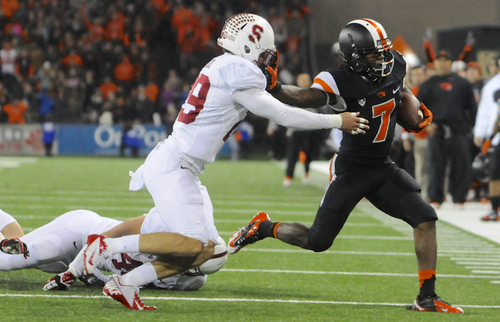 Oregon State's Brandin Cooks (7) runs against Stanford's Ed Reynolds (29) during the second half of an NCAA college football game in Corvallis, Ore., Saturday Oct. 26, 2013. Stanford beat Oregon State 20-12. (AP Photo/Greg Wahl-Stephens)