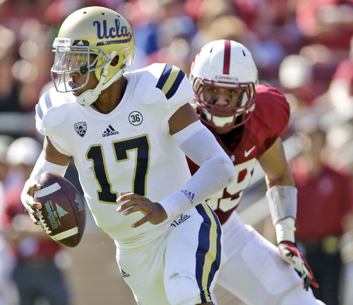 UCLA quarterback Brett Hundley (17) is chased by Stanford's Luke Kaumatule (99) during the first half of an NCAA college football game against Stanford on Saturday, Oct. 19, 2013, in Stanford, Calif. (AP Photo/Marcio Jose Sanchez)