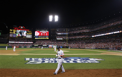 Boston Red Sox shortstop Stephen Drew walks back to the dugout after striking out to St. Louis Cardinals starting pitcher Adam Wainwright in the second inning of Game 5 of baseball's World Series Monday, Oct. 28, 2013, in St. Louis. (AP Photo/Matt Slocum)