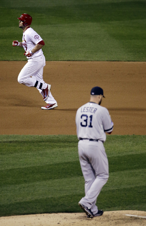 Boston Red Sox starting pitcher Jon Lester (31) walks back to the mound as St. Louis Cardinals' Matt Holliday rounds the bases after Holliday hit a home run during the fourth inning of Game 5 of baseball's World Series Monday, Oct. 28, 2013, in St. Louis. (AP Photo/David J. Phillip)