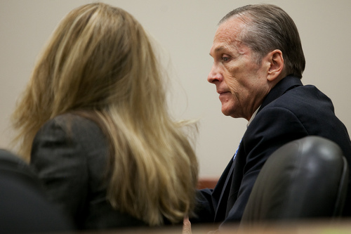 Mark Johnston  |  Pool  Martin MacNeill speaks to his attorney Susanne Gustin during his trial at 4th District Court in Provo Tuesday, Oct. 29, 2013. MacNeill is charged with murder for allegedly killing his wife Michele MacNeill in 2007.