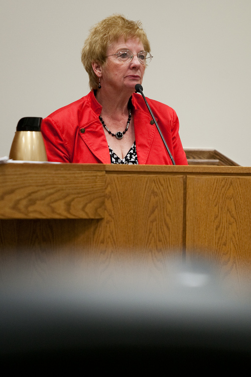 Mark Johnston  |  Pool  Roma Henrie, a former coworker with Martin MacNeill at the Utah State Developmental Center, testifies during MacNeill's trial at 4th District Court in Provo Tuesday, Oct. 29, 2013. MacNeill is charged with murder for allegedly killing his wife Michele MacNeill in 2007.