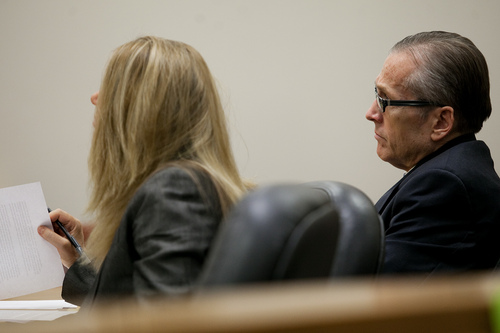 Mark Johnston     Pool  Martin MacNeill sits by his attorney Susanne Gustin during his trial at 4th District Court in Provo Tuesday, Oct. 29, 2013. MacNeill is charged with murder for allegedly killing his wife Michele MacNeill in 2007.