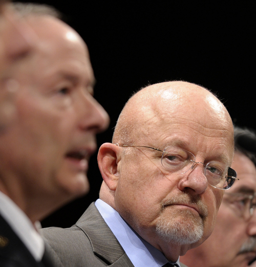 Director of National Intelligence James Clapper listens at right as National Security Agency Director Gen. Keith Alexander, testifies on Capitol Hill in Washington, Tuesday, Oct. 29, 2013, before the House Intelligence Committee hearing on potential changes to the Foreign Intelligence Surveillance Act (FISA). Faced with anger over revelations about U.S. spying at home and abroad, members of Congress suggested Tuesday that programs the Obama administration says are needed to combat terrorism may have gone too far.   (AP Photo/Susan Walsh) (AP Photo/Susan Walsh)
