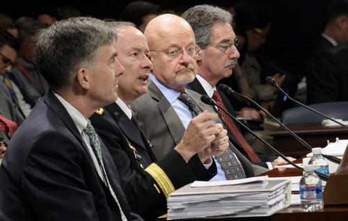 From left, National Security Agency Deputy Director Chris Inglis, National Security Agency Director Gen. Keith Alexander, Director of National Intelligence James Clapper and Deputy Attorney General James Cole, testify on Capitol Hill in Washington, Tuesday, Oct. 29, 2013, before the House Intelligence Committee hearing on potential changes to the Foreign Intelligence Surveillance Act (FISA). Faced with anger over revelations about U.S. spying at home and abroad, members of Congress suggested Tuesday that programs the Obama administration says are needed to combat terrorism may have gone too far.   (AP Photo/Susan Walsh)
