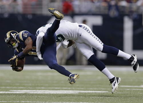 CORRECTS ID OF SEAHAWKS PLAYER TO CORNERBACK BRANDOWN BROWNER INSTEAD OF CLIFF AVRIL - St. Louis Rams wide receiver Tavon Austin (11) gets tackled by Seattle Seahawks cornerback Brandon Browner (39) during the first half of an NFL football game, Monday, Oct. 28, 2013, in St. Louis. (AP Photo/Michael Conroy)