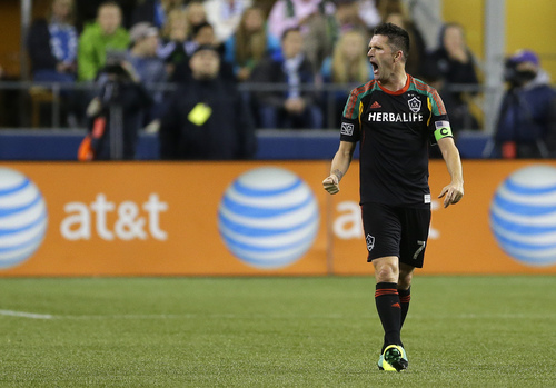 Los Angeles Galaxy's Robbie Keane celebrates after he scored a goal against the Seattle Sounders in the second half of an MLS soccer match, Sunday, Oct. 27, 2013, in Seattle. The Sounders and the Galaxy tied 1-1. (AP Photo/Ted S. Warren)