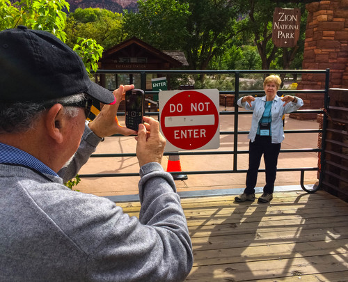 Trent Nelson  |  The Salt Lake Tribune Donna Rice makes a thumbs down gesture for a photo taken by her husband Barry after they travelled from Chicago to Zion National Park only to find it closed due to the government shutdown, Wednesday, October 9, 2013.