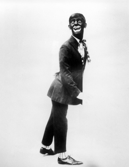 """This 1920s image shows comedian Eddie Cantor wearing blackface while performing """"If You Knew Susie."""" Historically, blackface emerged in the mid-19th century, representing a combination of put-down, fear and morbid fascination with black culture. Among the most prominent examples: Al Jolson and Eddie Cantor. Today, there's a fine line between mockery and tribute. (AP Photo, File)"""