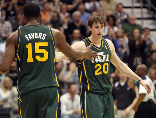 Rick Egan    The Salt Lake Tribune   Now that the Utah Jazz have offered a contract extension to power forward Derrick Favors (15), attention has shifted to whether they'll do the same for shooting guard Gordon Hayward (20). The pair are pictured here after Hayward hit a 3-pointer, giving the Jazz 87-76 lead with 2:56 left in a March 16 game against the  Memphis Grizzlies at EnergySolutions Arena.