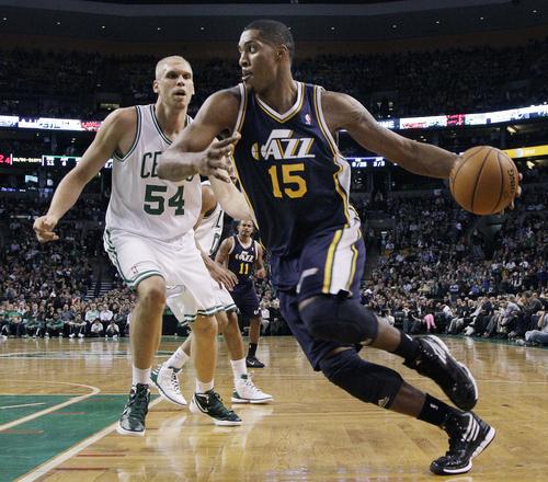 Utah Jazz forward Derrick Favors (15) drives against Boston Celtics center Greg Stiemsma (54) in the first half of an NBA basketball game in Boston, Wednesday, March 28, 2012. (AP Photo/Elise Amendola)