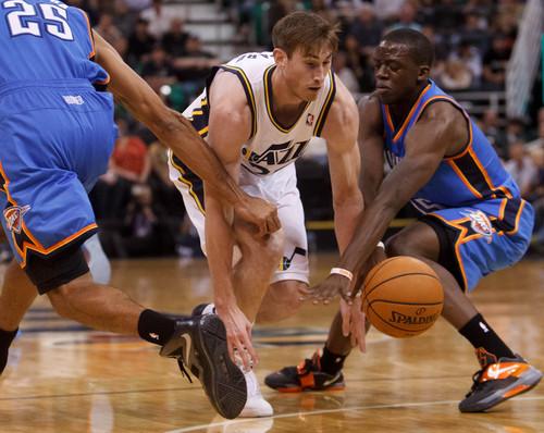 Trent Nelson  |  The Salt Lake Tribune Utah Jazz guard Gordon Hayward (20) goes after the ball, as the Utah Jazz host the Oklahoma City Thunder, NBA Basketball at EnergySolutions Arena in Salt Lake City, Wednesday October 30, 2013.