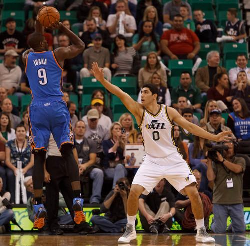 Trent Nelson  |  The Salt Lake Tribune Oklahoma City Thunder forward Serge Ibaka (9) shoots over Utah Jazz center Enes Kanter (0) as the Utah Jazz host the Oklahoma City Thunder, NBA Basketball at EnergySolutions Arena in Salt Lake City, Wednesday October 30, 2013.