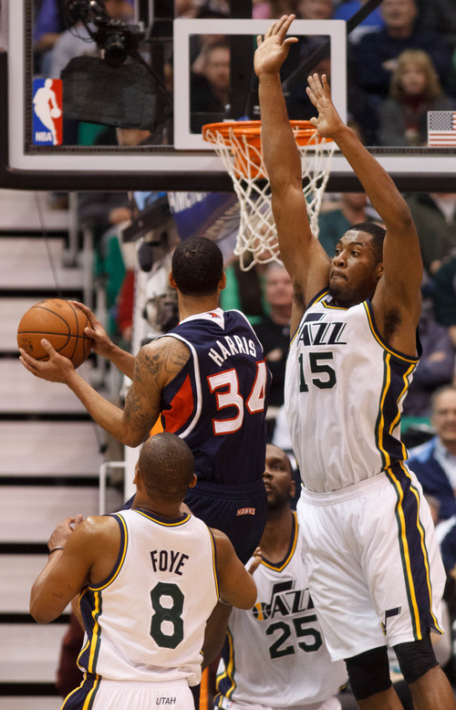 Trent Nelson  |  The Salt Lake Tribune Utah Jazz power forward Derrick Favors (15) defending Atlanta Hawks guard Devin Harris (34) as the Utah Jazz host the Atlanta Hawks, NBA basketball Wednesday, February 27, 2013 in Salt Lake City.