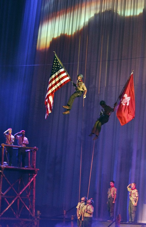 """Leah Hogsten     The Salt Lake Tribune The Church of Jesus Christ of Latter-day Saints and the Boy Scouts of America presented an original stage production about the history and values of Scouting. """"A Century of Honor"""" commemorating the 100-year partnership between the LDS Church and the BSA, Tuesday, October 29, 2014 at the Conference Center.  The program will featured multiple choirs, historical reenactment, dynamic set design, and multiple special effects drawing upon the skills and outdoor experiences that are hallmarks of Scouting."""