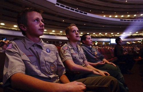 """Leah Hogsten     The Salt Lake Tribune l-r Cameron Askelson, Garrett Allan and Justin Ackley from Troop 1119 in Highland watch the presentation. The Church of Jesus Christ of Latter-day Saints and the Boy Scouts of America presented an original stage production about the history and values of Scouting. """"A Century of Honor"""" commemorating the 100-year partnership between the LDS Church and the BSA, Tuesday, October 29, 2014 at the Conference Center.  The program will featured multiple choirs, historical reenactment, dynamic set design, and multiple special effects drawing upon the skills and outdoor experiences that are hallmarks of Scouting."""