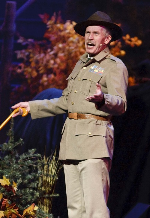 """Leah Hogsten     The Salt Lake Tribune Lord Robert Stephenson Smyth Baden-Powell, founder of the scouting movement speaks to the scouts during """"The Early Years"""" section of the presentation. The Church of Jesus Christ of Latter-day Saints and the Boy Scouts of America presented an original stage production about the history and values of Scouting. """"A Century of Honor"""" commemorating the 100-year partnership between the LDS Church and the BSA, Tuesday, October 29, 2014 at the Conference Center.  The program will featured multiple choirs, historical reenactment, dynamic set design, and multiple special effects drawing upon the skills and outdoor experiences that are hallmarks of Scouting."""
