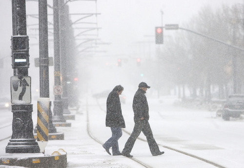 |  Tribune file photo  Salt Lake City is asking for public input on a proposal to restrict on-street parking during snowstorms.