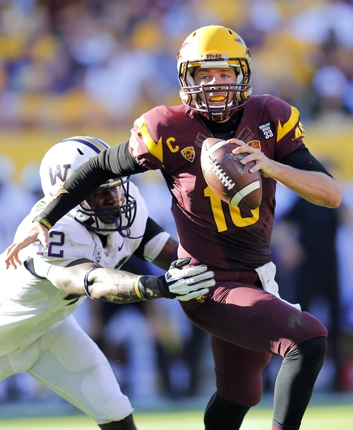 Arizona State quarterback Taylor Kelly (10) is chased down by Washington linebacker Cory Littleton, left, during the first half of an NCAA college football game, Saturday, Oct. 19, 2013, in Tempe, Ariz. (AP Photo/Matt York)