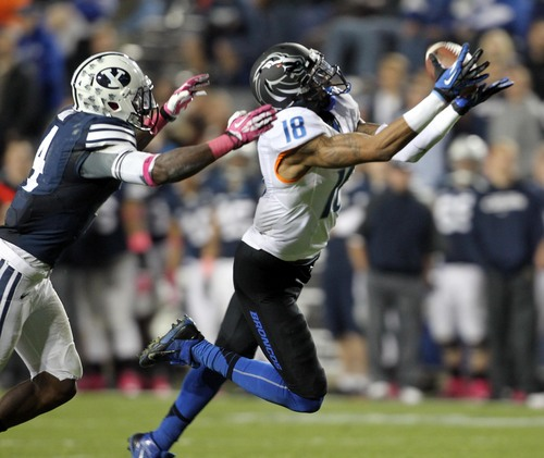Boise State wide receiver Aaron Burks (18) hauls in a long pass defended by BYU defender Robertson Daniel Friday Oct. 15, 2013 at LaVell Edwards Stadium in Provo, Utah. (AP Photo/The Idaho Statesman, Darin Oswald)