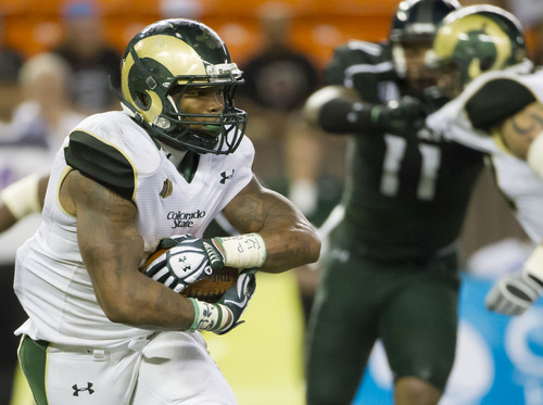 Colorado State running back Kapri Bibbs (5) looks for an opening in the Hawaii defensive line in the fourth quarter of an NCAA college football game Saturday, Oct. 26, 2013, in Honolulu. Colorado State defeated Hawaii 35-28. (AP Photo/Eugene Tanner)