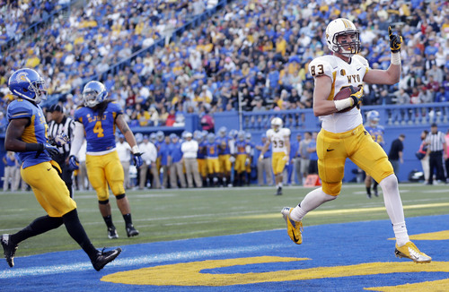 Wyoming wide receiver Jake Maulhardt celebrates his touchdown against San Jose State during the first half of an NCAA college football game on Saturday, Oct. 26, 2013, in San Jose, Calif. (AP Photo/Marcio Jose Sanchez)