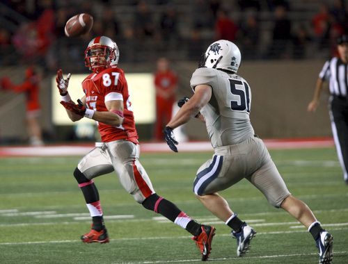 New Mexico's Jeric Magnant catches a pass in front of Utah State's Jake Doughty during the first half of an NCAA college football game Saturday, Oct. 19, 2013, at University Stadium in Albuquerque, N.M. (AP Photo by Eric Draper)