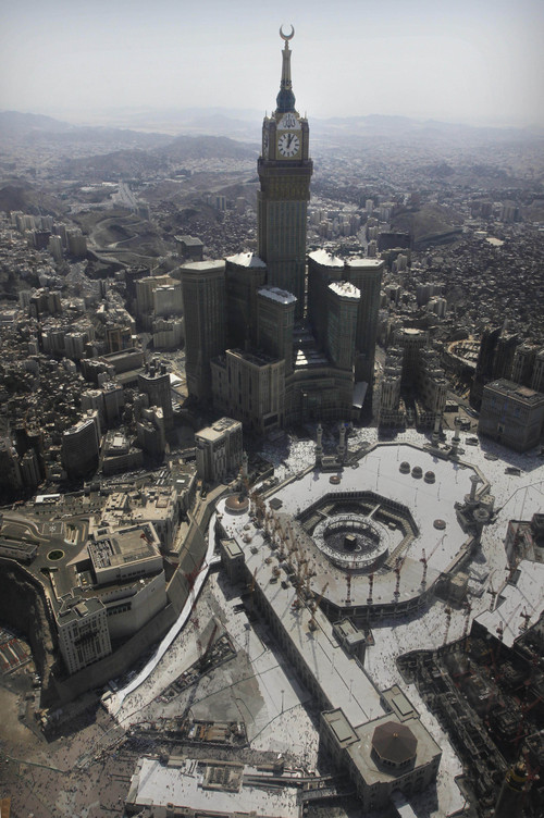 The Abraj Al-Bait Towers, with the tallest clock tower in the world with the world's largest clock face, overlooks the Grand Mosque and its expansion in Mecca, Saudi Arabia, Wednesday, Oct. 16, 2013. More than 2 million pilgrims -- about 1 million fewer than last year -- perform the hajj, a central pillar of Islam and one that able-bodied Muslims must make once in their lives, is a four-day spiritual cleansing based on centuries of interpretation of the traditions of Prophet Muhammad. (AP Photo/Amr Nabil)