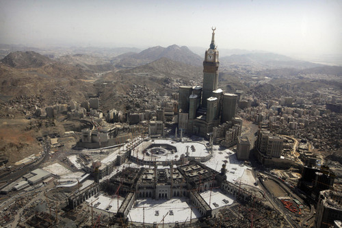 The tallest clock tower in the world with the world's largest clock face at the Abraj Al-Bait Towers overlooks the Grand Mosque and its expansion in Mecca, Saudi Arabia, Wednesday, Oct. 16, 2013. More than 2 million pilgrims -- about 1 million fewer than last year -- perform the hajj, a central pillar of Islam and one that able-bodied Muslims must make once in their lives, is a four-day spiritual cleansing based on centuries of interpretation of the traditions of Prophet Muhammad. (AP Photo/Amr Nabil)
