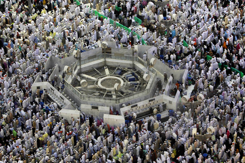 Muslim pilgrims surround a washing area as they pray at sunset outside the Grand Mosque in the Muslim holy city of Mecca, Saudi Arabia, Thursday, Oct. 10, 2013. Every Muslim is required to perform the hajj, or pilgrimage, to Mecca at least once in his or her lifetime if able to do so. (AP Photo/Amr Nabil)