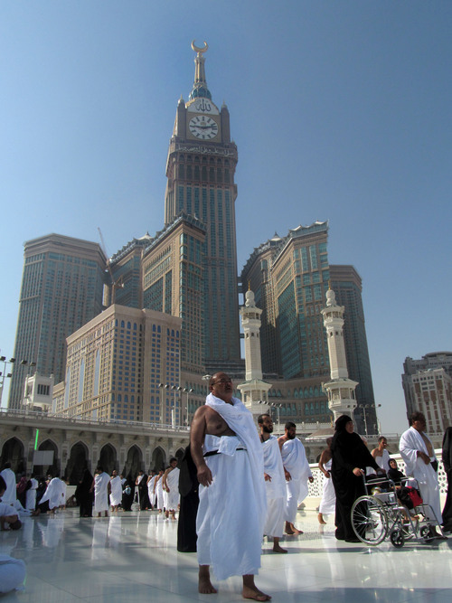 The tallest clock tower in the world with the world's largest clock face, atop the Abraj Al-Bait Towers, overshadows Muslim pilgrims as they circle around the Kaaba, in the Muslim holy city of Mecca, Saudi Arabia, Sunday, Oct. 13, 2013. The hajj, a central pillar of Islam and one that able-bodied Muslims must make once in their lives, is a four-day spiritual cleansing based on centuries of interpretation of the traditions of Prophet Muhammad. (AP Photo/Amr Nabil)