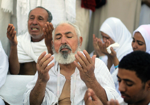 Tunisian Muslim pilgrims pray on a rocky hill called the Mountain of Mercy, near the holy city of Mecca, Saudi Arabia, Monday, Oct. 14, 2013. The hajj, a central pillar of Islam and one that able-bodied Muslims must make once in their lives, is a four-day spiritual cleansing based on centuries of interpretation of the traditions of Prophet Muhammad. (AP Photo/Amr Nabil)
