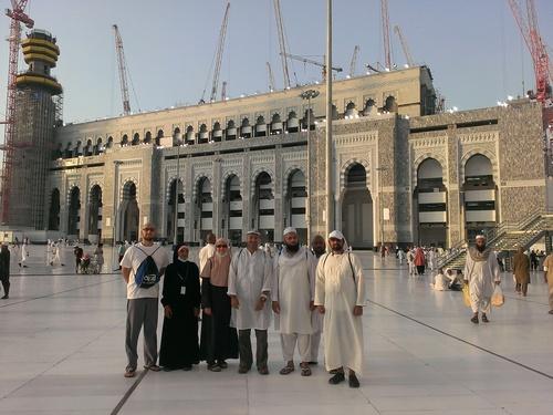 A group of Utah pilgrims at the hajj. Left to right:  Faisal Ahmed, Fauziah Bymaster, Zayba Hoda, Tariq Malik, Imam Shuaib, a friend of the group, and Daanish Hoda. Courtesy Saba Hoda