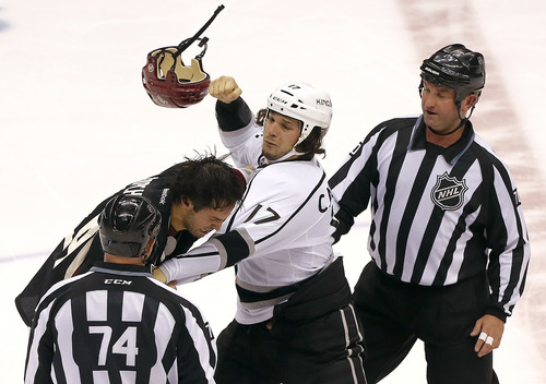 Phoenix Coyotes' Kyle Chipchura, upper left, fights with Los Angeles Kings' Daniel Carcillo (17) during the second period of an NHL hockey game, Tuesday, Oct. 29, 2013, in Glendale, Ariz. (AP Photo/Matt York)