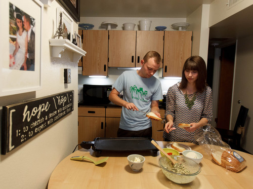 Trent Nelson     The Salt Lake Tribune Jonathan and Courtney Hope prepare dinner in their Provo apartment Wednesday, September 11, 2013. The couple are weighing their health insurance options including how the Affordable Care Act will affect them.