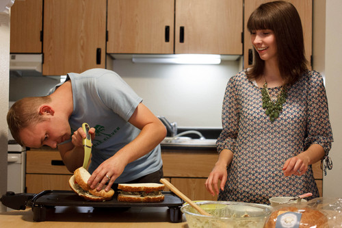 Trent Nelson     The Salt Lake Tribune Jonathan and Courtney Hope prepare dinner in their Provo apartment Wednesday, September 11, 2013. The couple is weighing health insurance options under the Affordable Care Act.