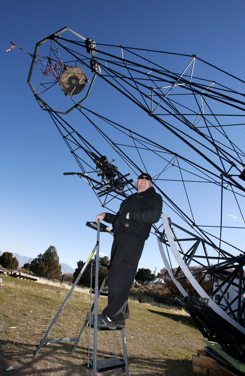 Steve Griffin  |  The Salt Lake Tribune  Mike Clements with his homemade 70-inch telescope in Herriman, Utah, Sunday, October 27, 2013. The 70-inch mirror and 35 foot length make it one of the biggest telescopes created by an amateur astronomer.