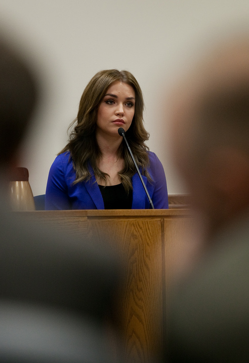 Mark Johnston  |  Pool  Sabrina MacNeill testifies at the trial of her adoptive father Martin MacNeill at 4th District Court in Provo Wednesday, Oct. 30, 2013. Martin MacNeill is charged with murder for allegedly killing his wife Michele MacNeill in 2007.