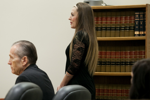 Mark Johnston  |  Pool  Vanessa MacNeill walks by her father Martin MacNeill, left, before taking the witness stand during his trial at 4th District Court in Provo Wednesday, Oct. 30, 2013. Martin MacNeill is charged with murder for allegedly killing his wife Michele MacNeill in 2007.
