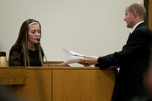 Mark Johnston  |  Pool  Vanessa MacNeill is handed documents by Chad Grunander, Utah County prosecutor, while testifying at the trial of her father Martin MacNeill at 4th District Court in Provo Wednesday, Oct. 30, 2013. Martin MacNeill is charged with murder for allegedly killing his wife Michele MacNeill in 2007.